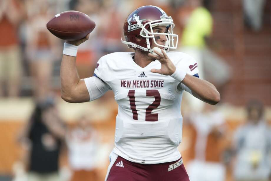Andrew McDonald of the New Mexico State Aggies throws a pass against the  Longhorns. Photo: Cooper Neill, Getty Images
