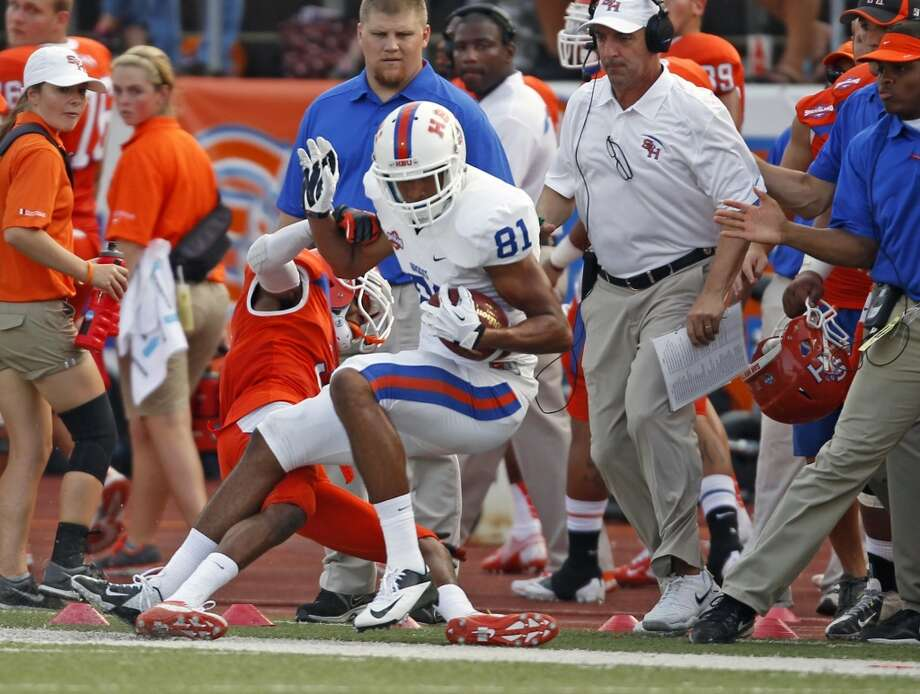 SHSU 74, HBU 0Houston Baptist's Wesley Lewis (81) is thrown out of bounds by Sam Houston State's Shelby Davis during the first half of a college football game, Saturday, August 31, 2013 at Bowers Stadium in Huntsville, TX. Photo: Eric Christian Smith, For The Chronicle