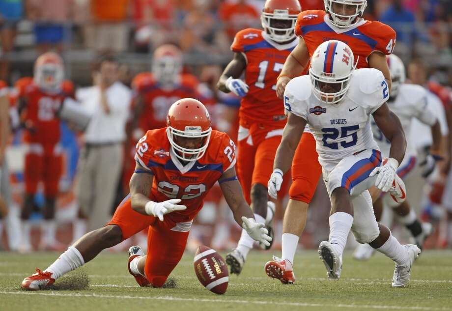 Sam Houston State's Tristan Eche, left, and Houston Baptist's Jackie Robinson, Jr. fight for a loose ball during the first half of a college football game, Saturday, August 31, 2013 at Bowers Stadium in Huntsville, TX. Photo: Eric Christian Smith, For The Chronicle