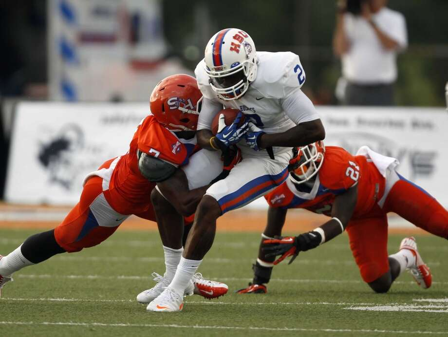 Houston Baptist's Darian Lizard (2) is tackled by Sam Houston State's Johntel Franklin during the first half of a college football game, Saturday, August 31, 2013 at Bowers Stadium in Huntsville, TX. Photo: Eric Christian Smith, For The Chronicle