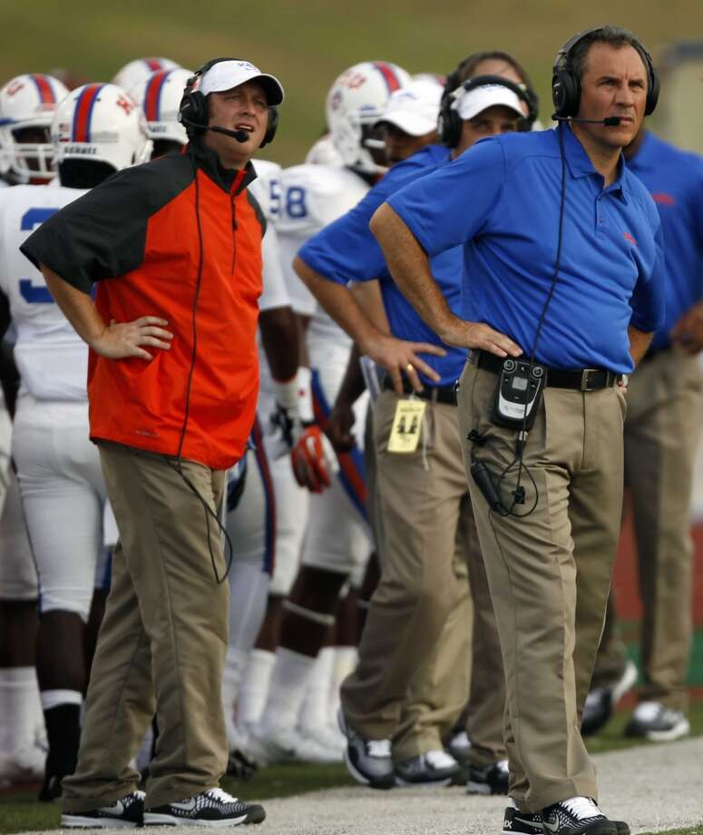 Houston Baptist head coach Vic Shealy, right, watches the action from the sidelines during the first half of a college football game against Sam Houston State, Saturday, August 31, 2013 at Bowers Stadium in Huntsville, TX. Photo: Eric Christian Smith, For The Chronicle