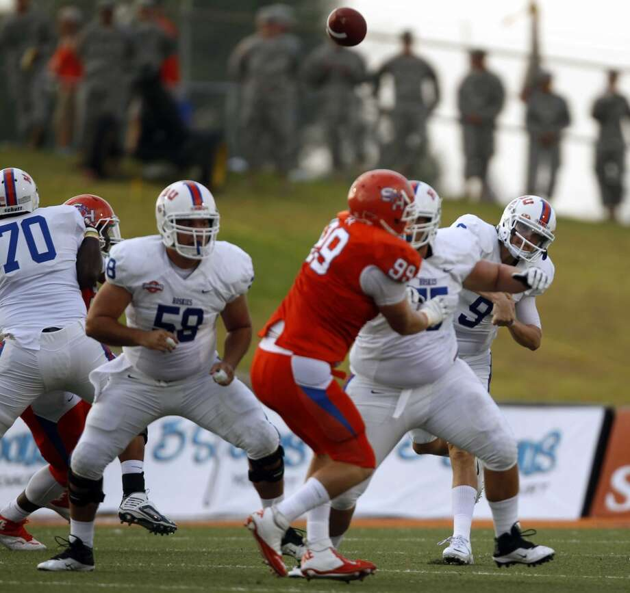 Houston Baptist quarterback Jonathan Fleming (9) throws a pass during the first half of a college football game against Sam Houston State, Saturday, August 31, 2013 at Bowers Stadium in Huntsville, TX. Photo: Eric Christian Smith, For The Chronicle
