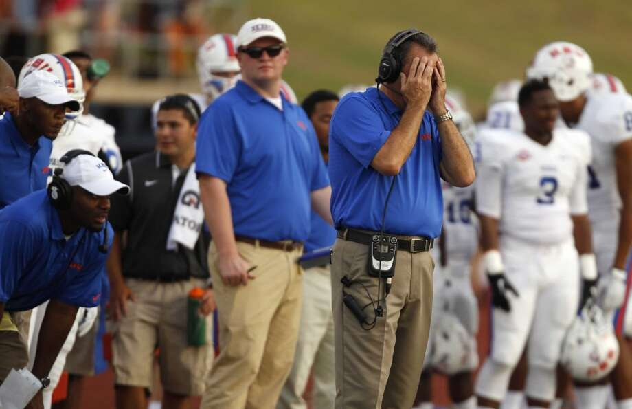 Houston Baptist head coach Vic Shealy reacts after Sam Houston State scored their second touchdown of the game during the first half of a college football game, Saturday, August 31, 2013 at Bowers Stadium in Huntsville, TX. Photo: Eric Christian Smith, For The Chronicle