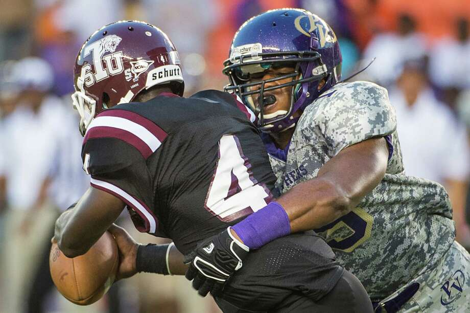 Prairie View linebacker Jamespaul Bryant, right, sacks Texas Southern's Homer Causey during the first half Saturday night. Photo: Smiley N. Pool, Staff / © 2013  Houston Chronicle