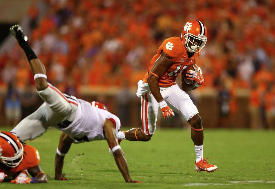 Clemson's Charone Peake uses his blockers as he tries to pick up extra yardage after a reception. Photo: Streeter Lecka, Staff / 2013 Getty Images
