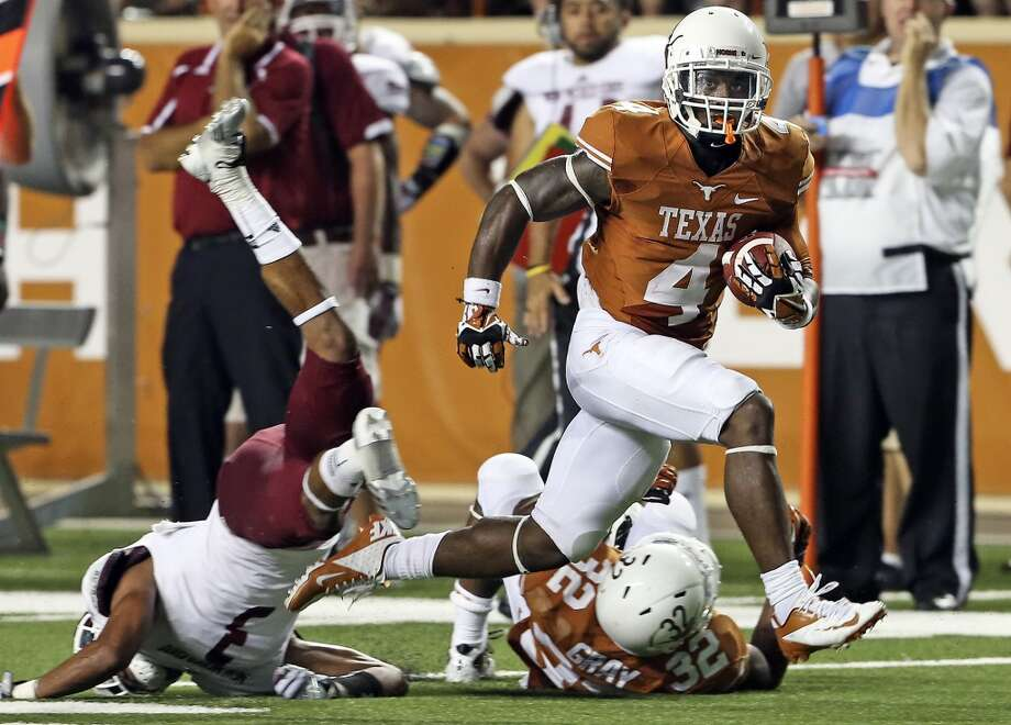 Daje Johnson adds another score for the Horns  as the second half starts as Texas hosts New Mexico State at Darrell K. Royal - Texas Memorial Stadium on August 31, 2013.