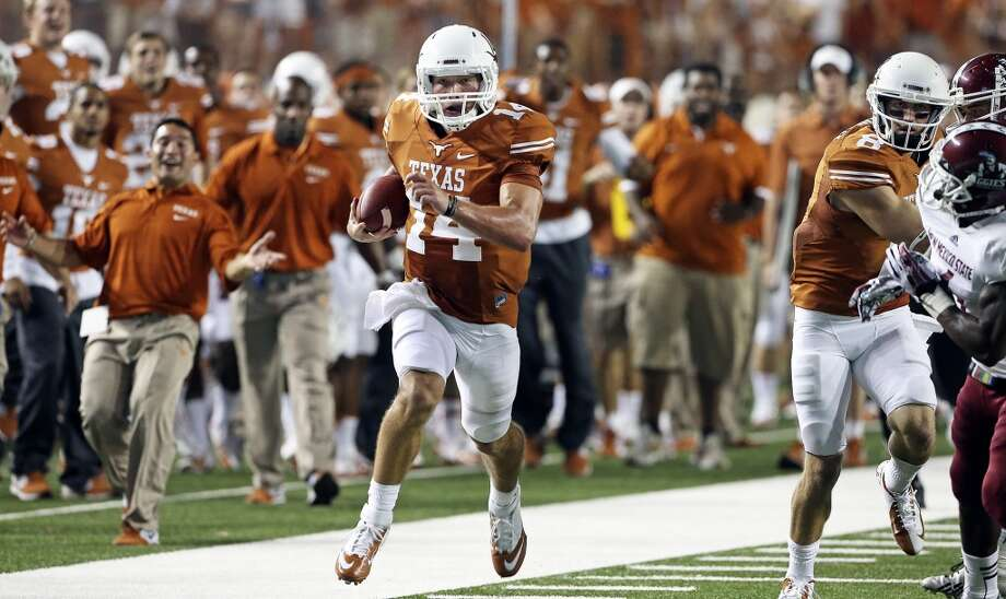 Quarterback David Ash sprints down the right sideline for a touchdown in the second half as Texas hosts New Mexico State at Darrell K. Royal - Texas Memorial Stadium on August 31, 2013.