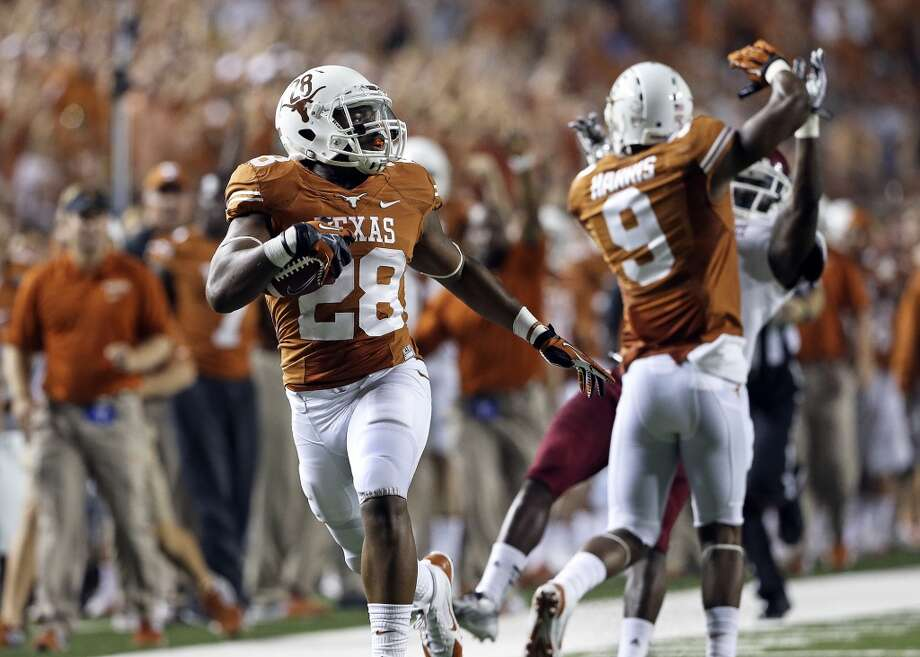 Malcolm Brown looks back on the field after sprinting out on the right for a long touchdown run in the second half as Texas hosts New Mexico State at Darrell K. Royal - Texas Memorial Stadium on August 31, 2013.