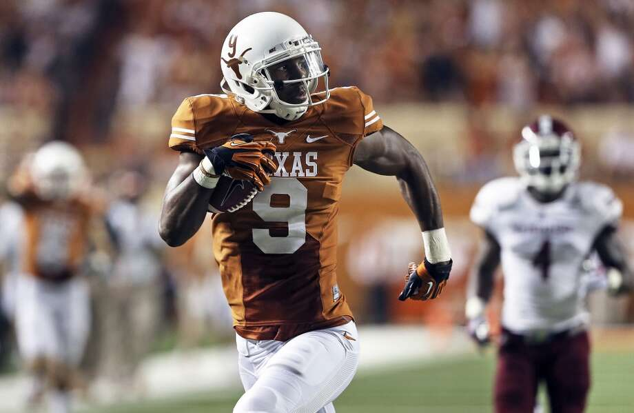 Receiver John Harris opens up the field and scores in the second quarter to break an offensive drought as Texas hosts New Mexico State at Darrell K. Royal - Texas Memorial Stadium on August 31, 2013.