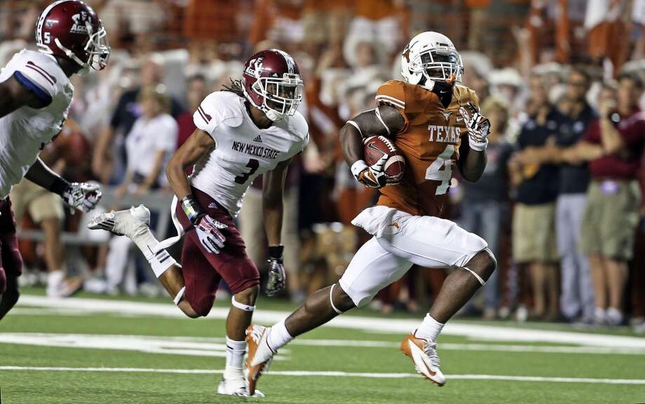 Receiver Daje Johnson adds another late second quarter touchdown as Texas hosts New Mexico State at Darrell K. Royal - Texas Memorial Stadium on August 31, 2013.