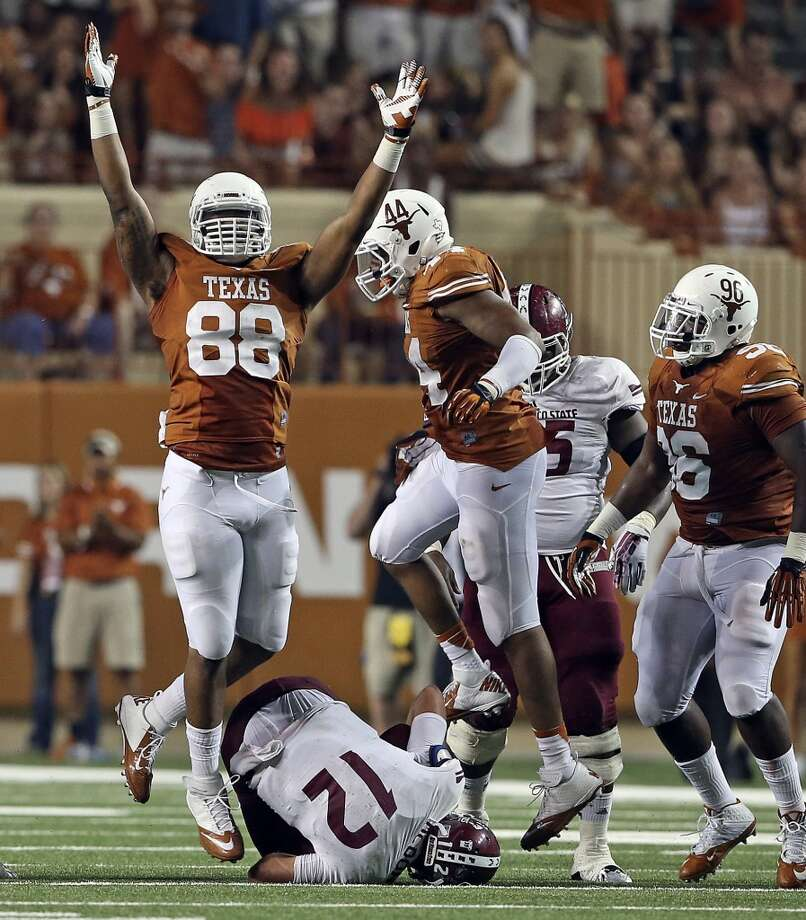 Defensive end Cedric Reed celebrates a sack of Aggie quarterback Andrew McDonald in the second half as Texas hosts New Mexico State at Darrell K. Royal - Texas Memorial Stadium on August 31, 2013.