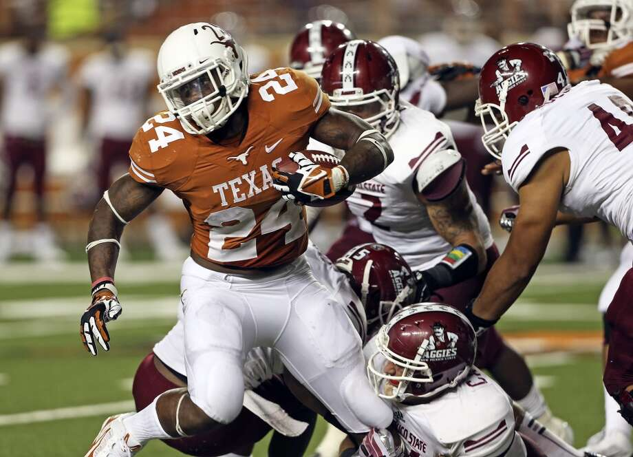 Longhorn running back Joe Bergeron breaks loose from a pack of tacklers as Texas hosts New Mexico State at Darrell K. Royal - Texas Memorial Stadium on August 31, 2013.