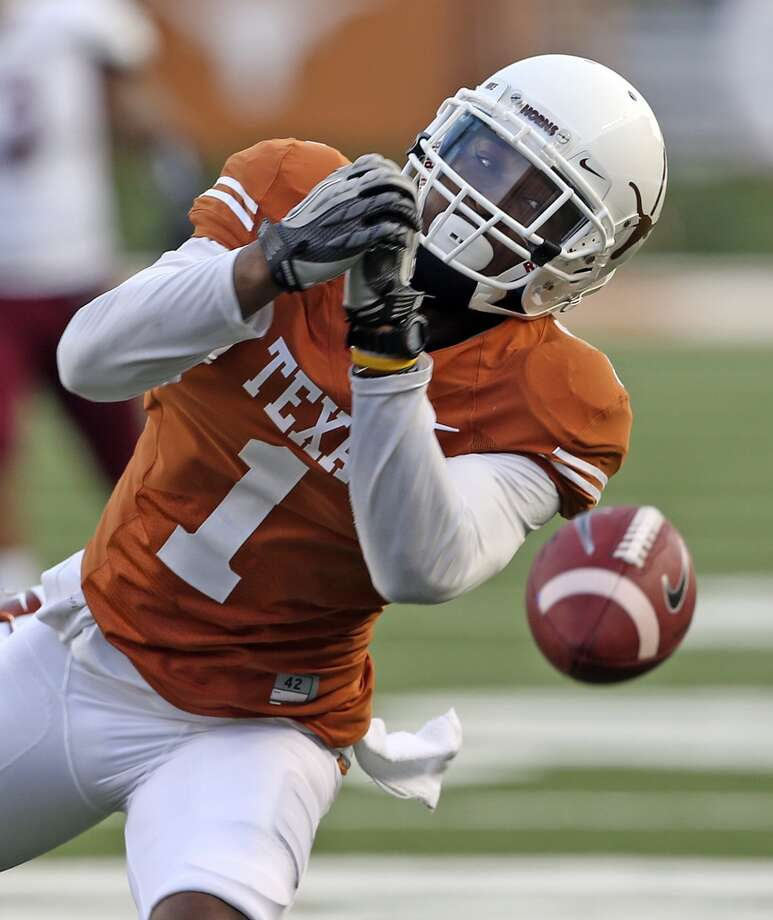 Longhorn receiver Mike Davis fails to handle a long pass in the open in the first half as Texas hosts New Mexico State at Darrell K. Royal - Texas Memorial Stadium on August 31, 2013.