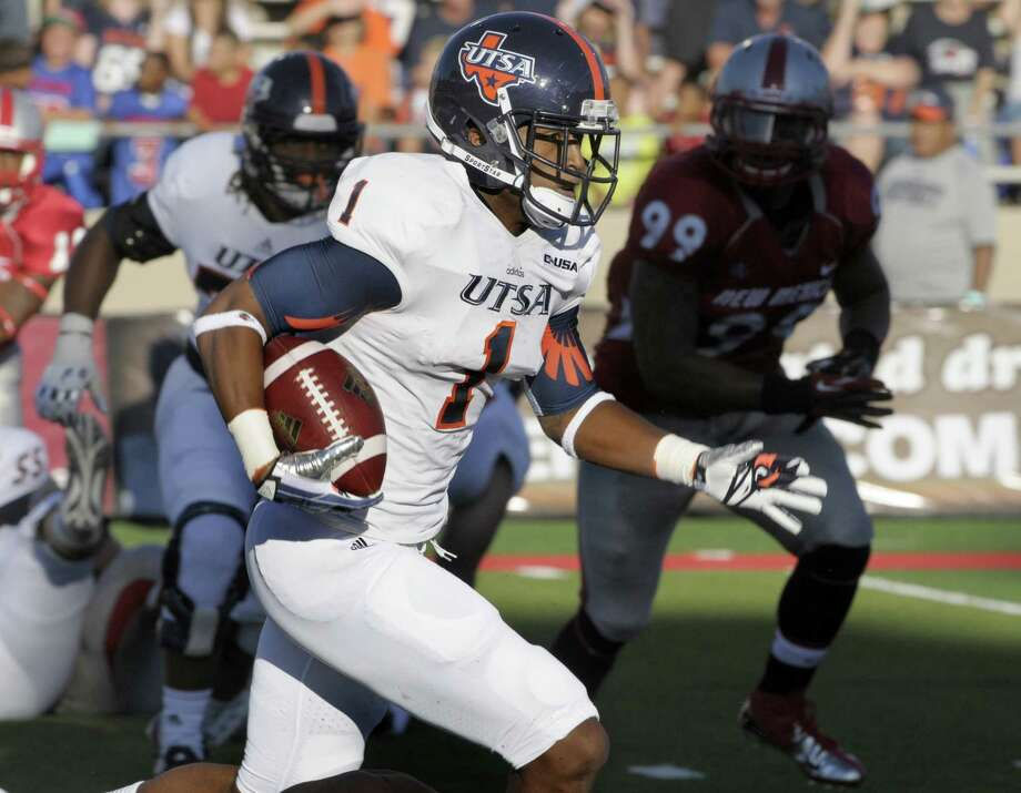 UTSA's Kam Jones looks for more yards on one of his five receptions in the season opener against New Mexico on Saturday. Jones had a key 35-yard reception on a 99-yard drive that sealed the victory. Photo: Greg Sorber / Albuquerque Journal