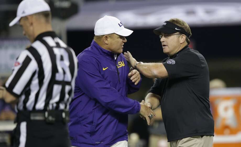 TCU head coach Gary Patterson, right, and LSU head coach Les Miles shake hands before an NCAA college football game  Saturday, Aug. 31, 2013, in Arlington, Texas. (AP Photo/LM Otero) Photo: Associated Press