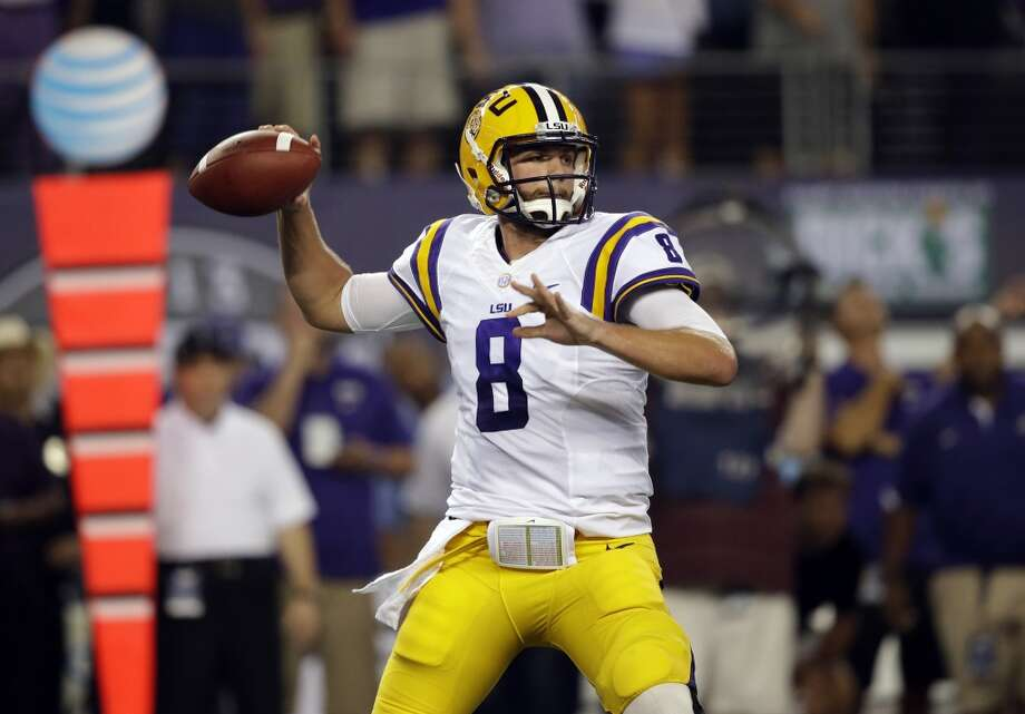 LSU quarterback Zach Mettenberger (8) passes during the first half of an NCAA college football game against the TCU Saturday, Aug. 31, 2013, in Arlington, Texas. (AP Photo/LM Otero) Photo: Associated Press