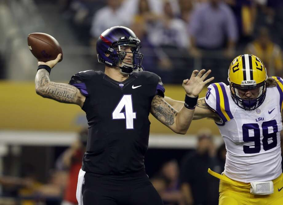 TCU quarterback Casey Pachall (4) passes under pressure from LSU defensive end Jordan Allen (98) during the first half of an NCAA college football game, Saturday, Aug. 31, 2013, in Arlington, Texas. (AP Photo/LM Otero) Photo: Associated Press