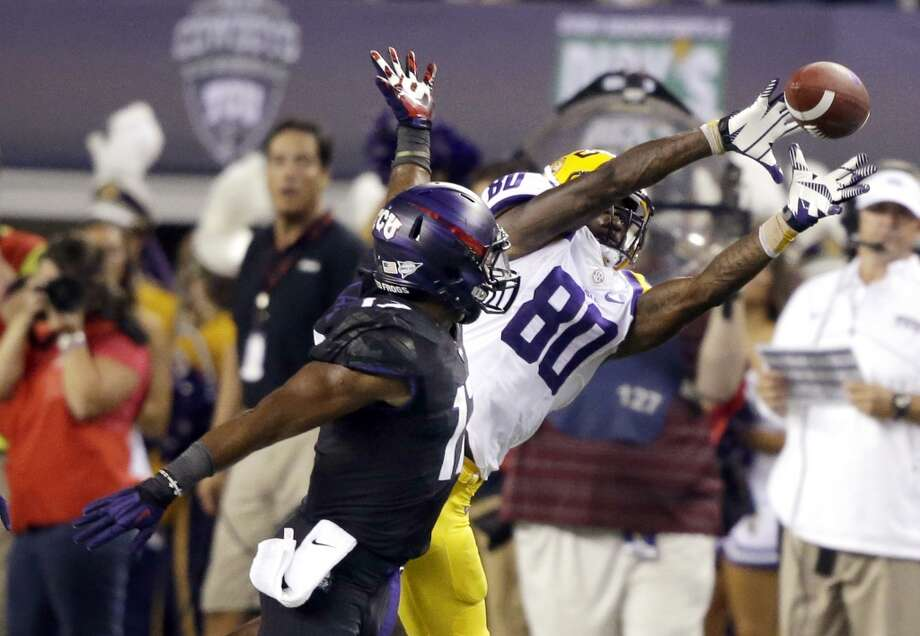 LSU wide receiver Jarvis Landry (80) catches a pass against TCU safety Sam Carter during the first half of an NCAA college football game, Saturday, Aug. 31, 2013, in Arlington, Texas. (AP Photo/LM Otero) Photo: Associated Press