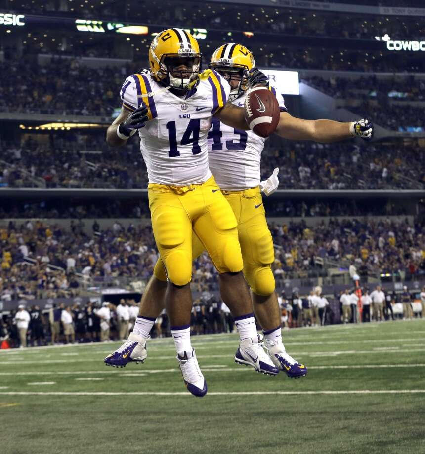 LSU running back Terrence Magee (14) celebrates scoring a touchdown with teammate Connor Neighbors (43) during the second half of an NCAA college football game against the TCU, Saturday, Aug. 31, 2013, in Arlington, Texas. (AP Photo/LM Otero) Photo: Associated Press