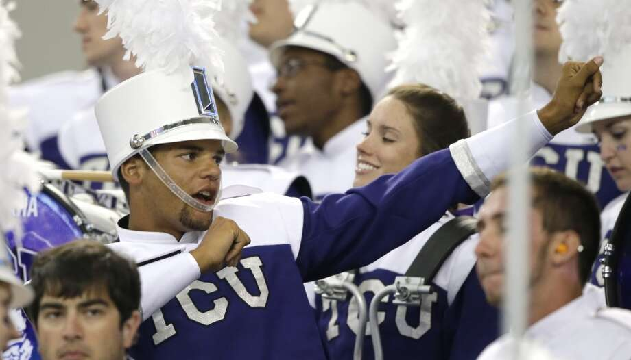 A TCU band member dances before an NCAA college football game Saturday, Aug. 31, 2013, in Arlington, Texas. (AP Photo/LM Otero) Photo: Associated Press