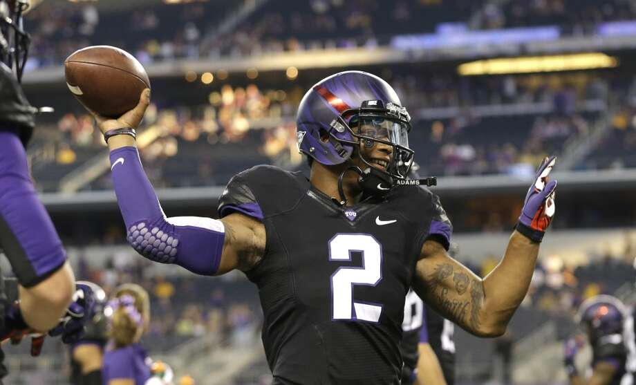 TCU quarterback Trevone Boykin (2) warms up before an NCAA college football game against the LSU Saturday, Aug. 31, 2013, in Arlington, Texas. (AP Photo/LM Otero) Photo: Associated Press