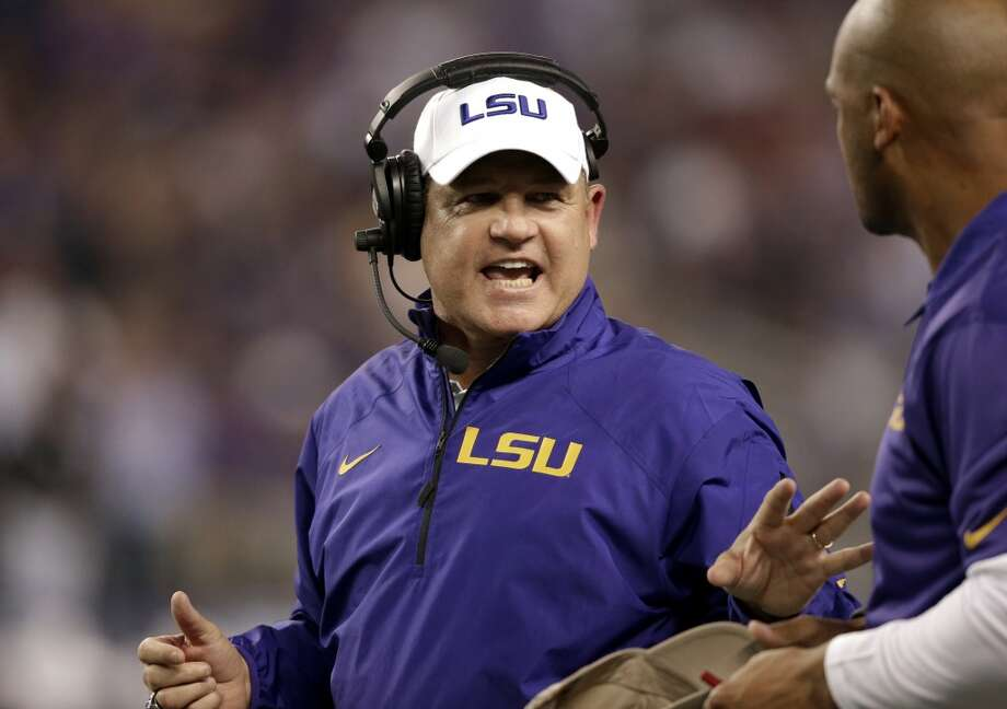 LSU head coach Les Miles, left, talks with his staff on the sidelines in the final seconds of the first half of an NCAA college football game against the TCU, Saturday, Aug. 31, 2013, in Arlington, Texas. (AP Photo/LM Otero) Photo: Associated Press