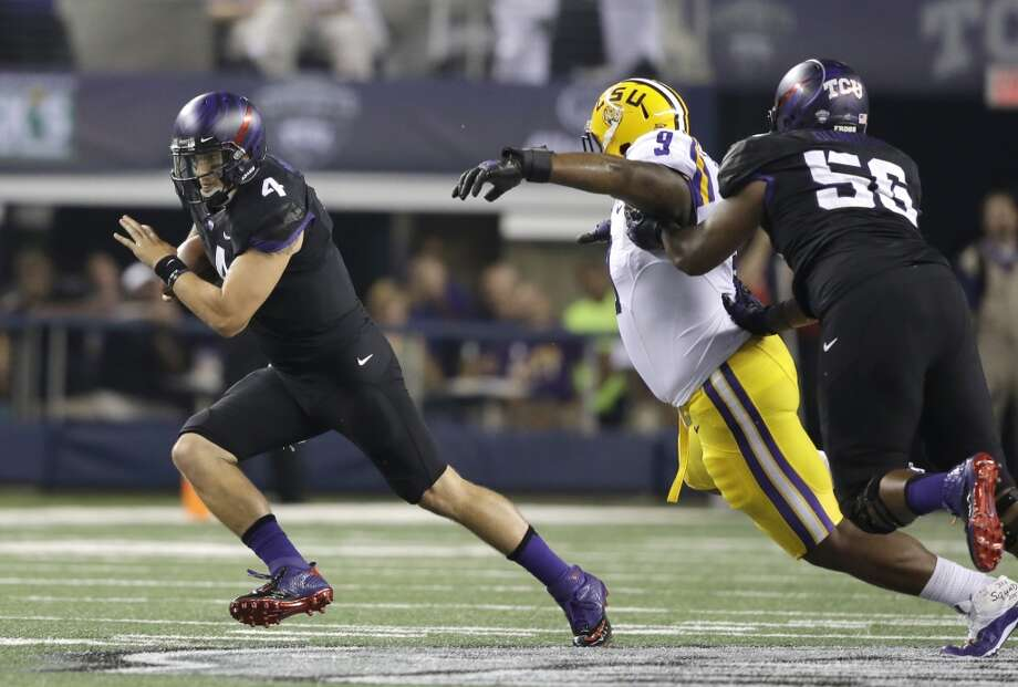 TCU quarterback Casey Pachall (4) runs from LSU defensive tackle Ego Ferguson (9) as TCU offensive tackle James Dunbar (56) tries to block during the first half of an NCAA college football game  Saturday, Aug. 31, 2013, in Arlington, Texas. (AP Photo/LM Otero) Photo: Associated Press