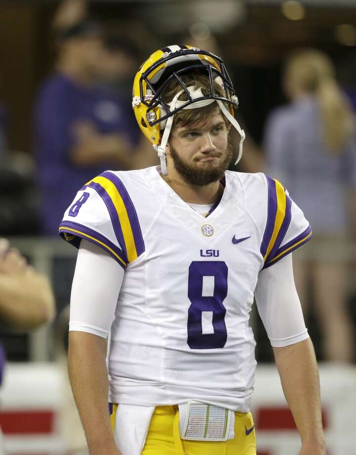 LSU quarterback Zach Mettenberger (8) get ready to warm up before an NCAA college football game  against the TCU Saturday, Aug. 31, 2013, in Arlington, Texas. (AP Photo/LM Otero) Photo: Associated Press