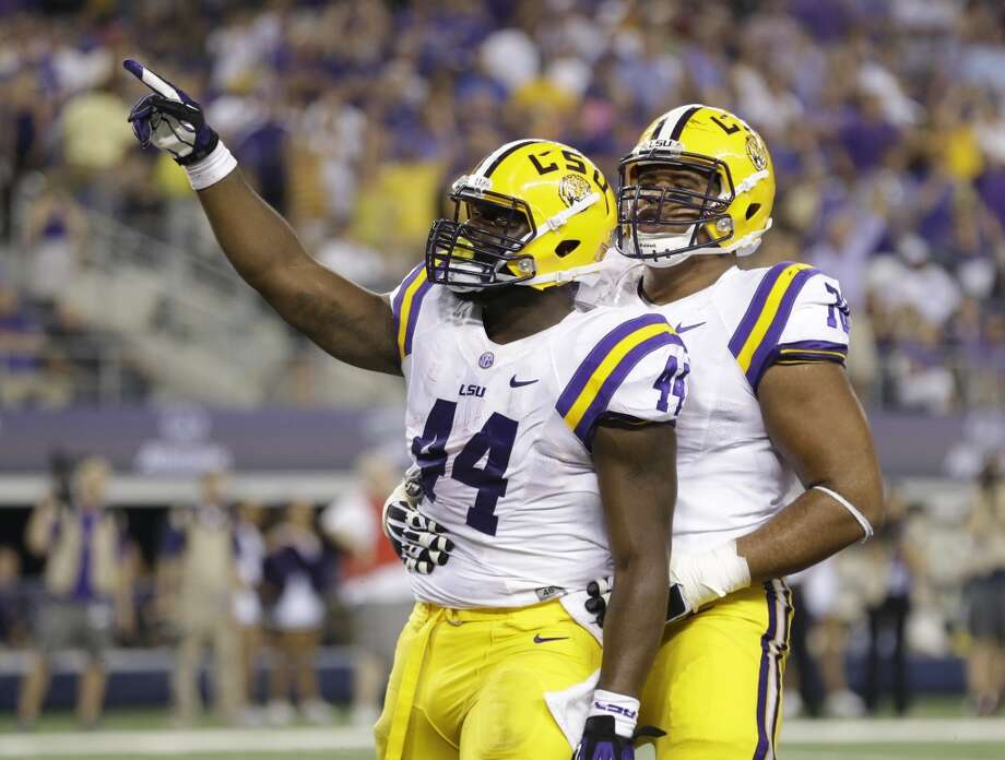 LSU fullback J.C. Copeland (44) celebrates after scoring a touchdown with teammate offensive tackle La'el Collins during the first half of an NCAA college football game against TCU, Saturday, Aug. 31, 2013, in Arlington, Texas. (AP Photo/LM Otero) Photo: Associated Press