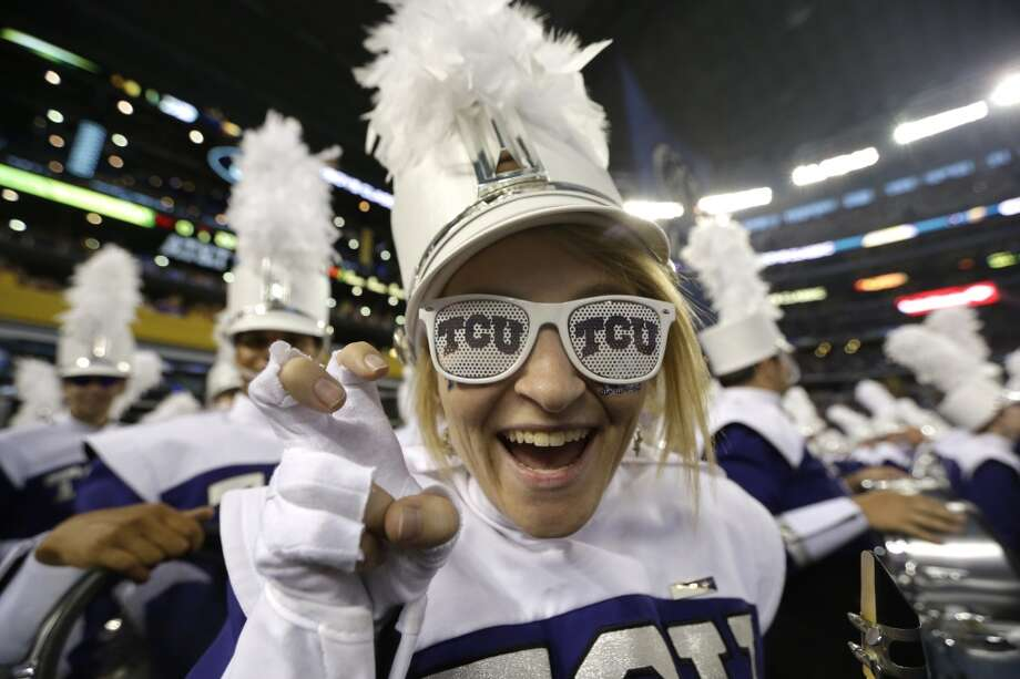 A TCU band member shows her team spirit before an NCAA college football game between LSU and TCU Saturday, Aug. 31, 2013, in Arlington, Texas. (AP Photo/LM Otero) Photo: Associated Press