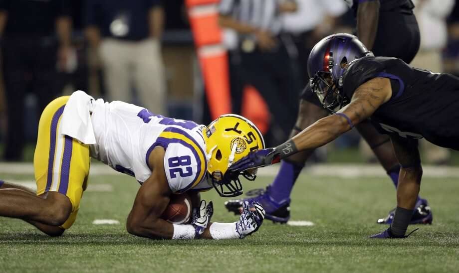LSU's James Wright (82) recovers a fumble on the kick off against TCU's Brandon Carter (3) during the first half of an NCAA college football game on Saturday, Aug. 31, 2013, in Arlington, Texas. (AP Photo/LM Otero) Photo: Associated Press