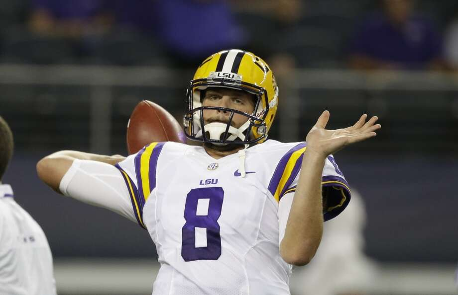 LSU quarterback Zach Mettenberger (8) warms up before an NCAA college football game  against the TCU Saturday, Aug. 31, 2013, in Arlington, Texas. (AP Photo/LM Otero) Photo: Associated Press