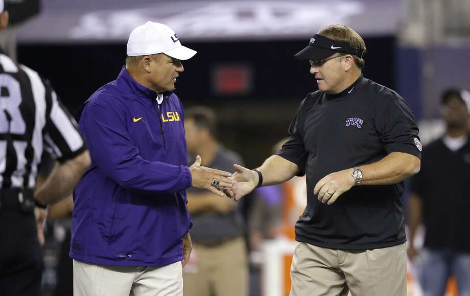 TCU head coach Gary Patterson, right, and LSU head coach Les Miles greet each other before an NCAA college football game on Saturday, Aug. 31, 2013, in Arlington, Texas. (AP Photo/LM Otero) Photo: Associated Press