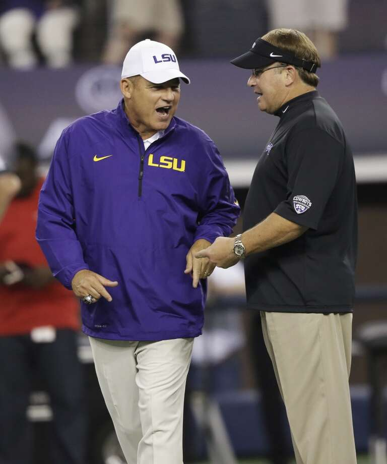 TCU head coach Gary Patterson, right, and LSU head coach Les Miles chat before an NCAA college football game on Saturday, Aug. 31, 2013, in Arlington, Texas. (AP Photo/LM Otero) Photo: Associated Press