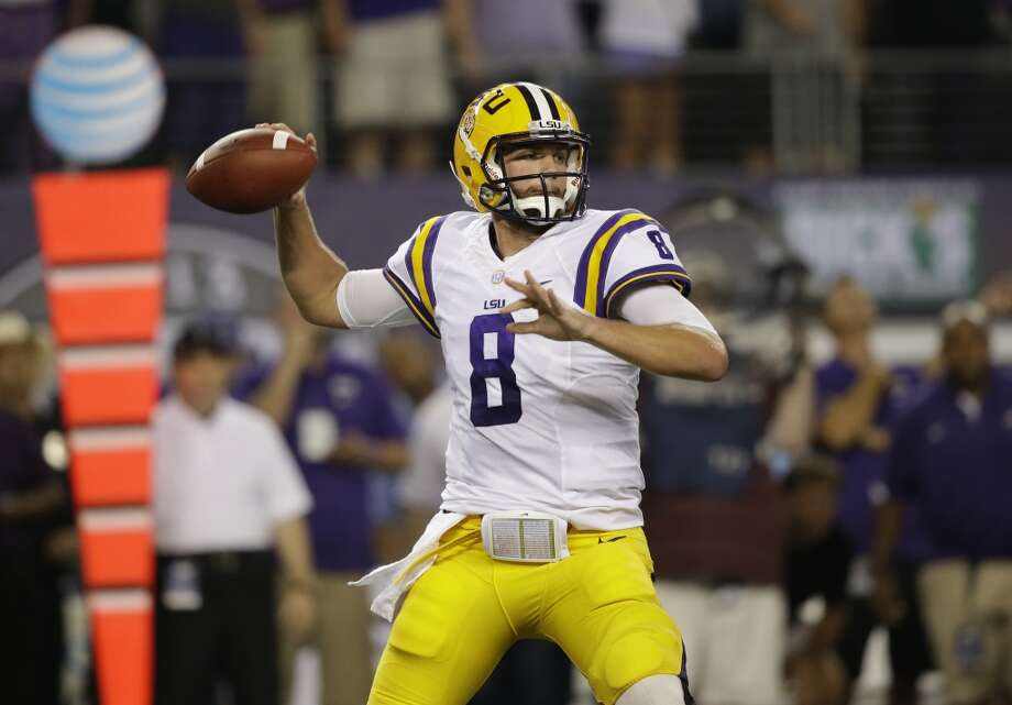 LSU quarterback Zach Mettenberger (8) passes during the first half of an NCAA college football game against TCU, Saturday, Aug. 31, 2013, in Arlington, Texas. (AP Photo/LM Otero) Photo: Associated Press