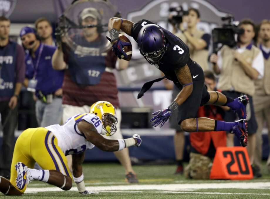 TCU wide receiver Brandon Carter (3) jumps against LSU safety Ronald Martin (26) after a reception during the first half of an NCAA college football game Saturday, Aug. 31, 2013, in Arlington, Texas. (AP Photo/LM Otero) Photo: Associated Press