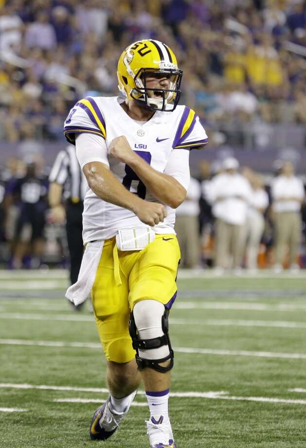 LSU quarterback Zach Mettenberger (8)  celebrates a touchdown by teammate  J.C. Copeland during the first half of an NCAA college football game against TCU Saturday, Aug. 31, 2013, in Arlington, Texas. (AP Photo/LM Otero) Photo: Associated Press