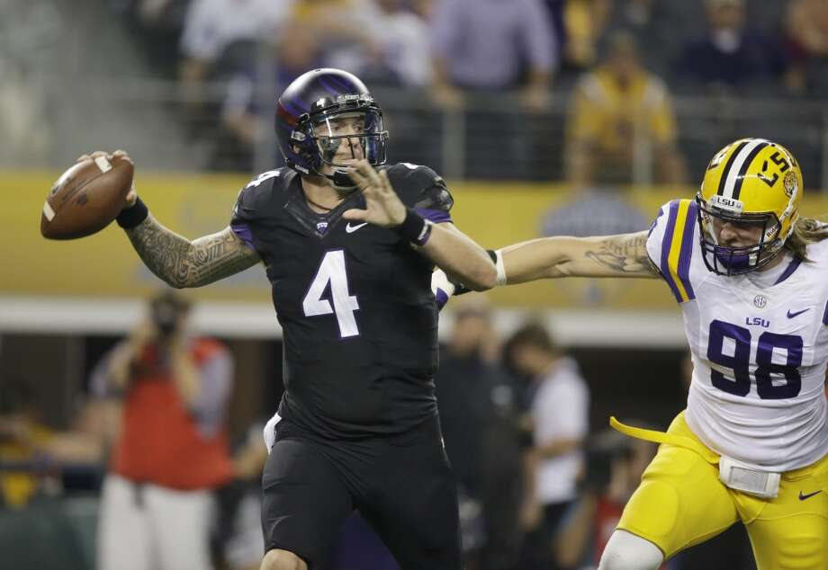 TCU quarterback Casey Pachall (4) passes under pressure from LSU defensive end Jordan Allen (98) during the first half of an NCAA college football game  Saturday, Aug. 31, 2013, in Arlington, Texas. (AP Photo/LM Otero) Photo: Associated Press