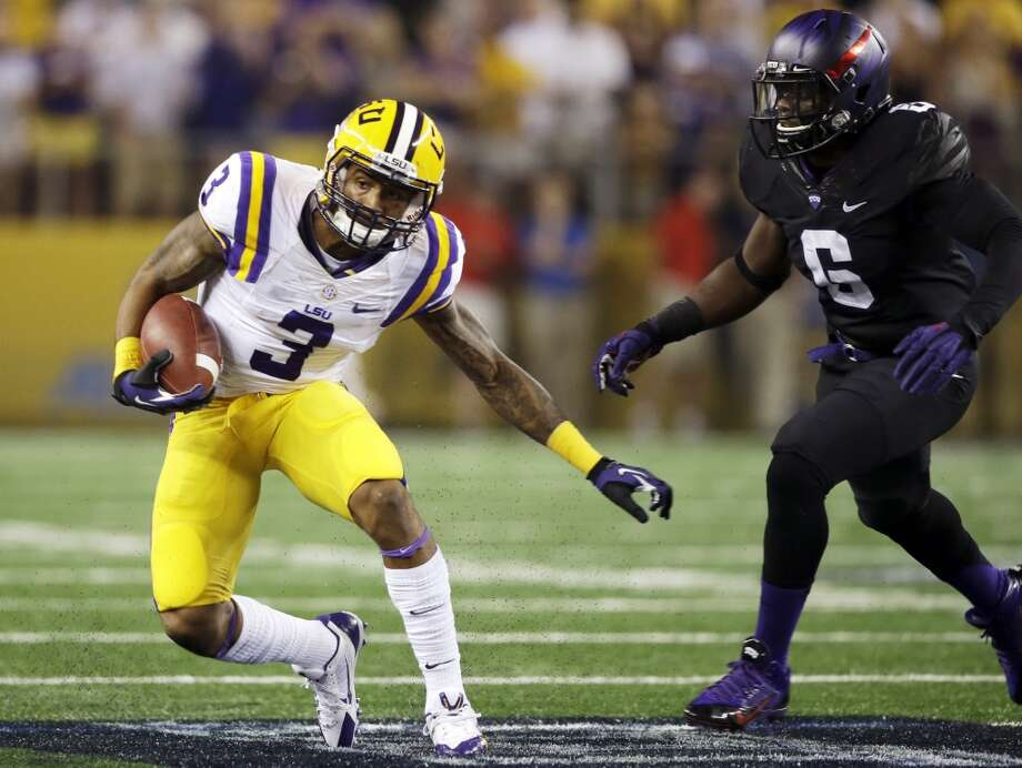 LSU wide receiver Odell Beckham (3) runs past TCU safety Elisha Olabode (6) during the first half of an NCAA college football game, Saturday, Aug. 31, 2013, in Arlington, Texas. (AP Photo/LM Otero) Photo: Associated Press