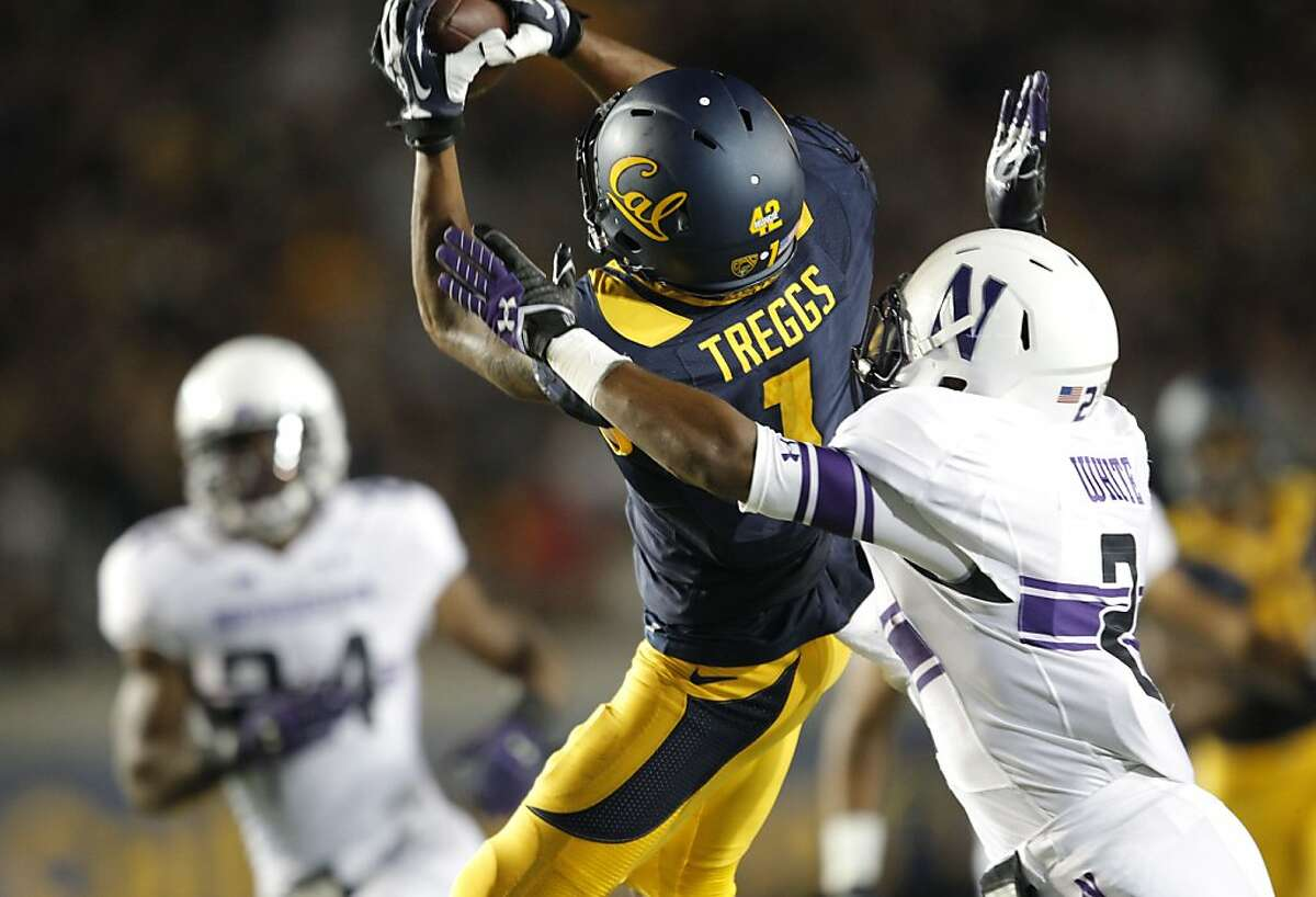 Bears' Bryce Treggs, (1) makes a catch to set up a third quarter score, defended by Northwestern's Dwight White, (2) during the third quarter, as the Cal Berkeley Golden Bears take on the Northwestern Wildcats at Memorial stadium in Berkeley , Calif. on Saturday August 31, 2013.