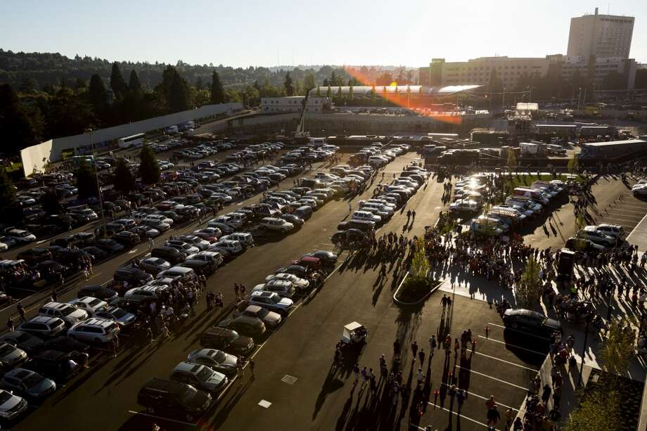 Tailgaters pack the parking lot before the opening season game against Boise State Saturday, August 31, 2013, in Seattle. (Jordan Stead, seattlepi.com) Photo: JORDAN STEAD, SEATTLEPI.COM