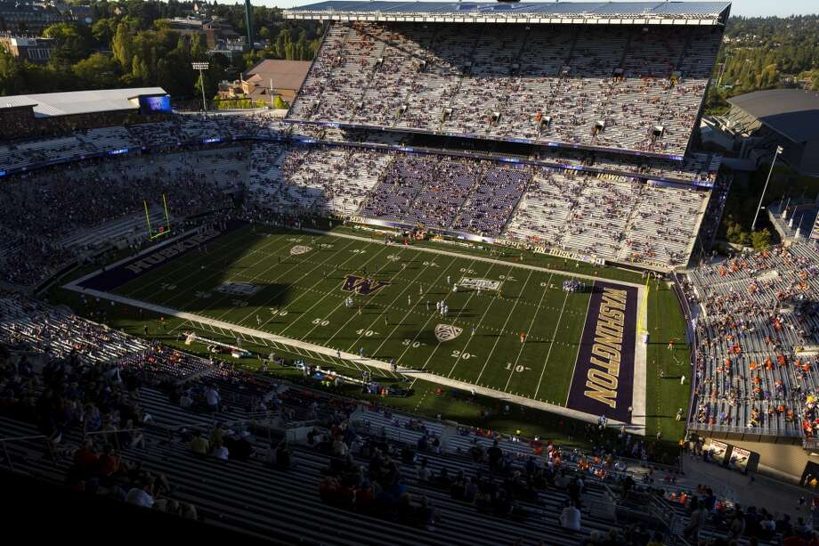 The stands begin to populate in the hours before the opening season Husky football  game against Boise State Saturday, August 31, 2013, in Seattle. (Jordan Stead, seattlepi.com) Photo: JORDAN STEAD, SEATTLEPI.COM
