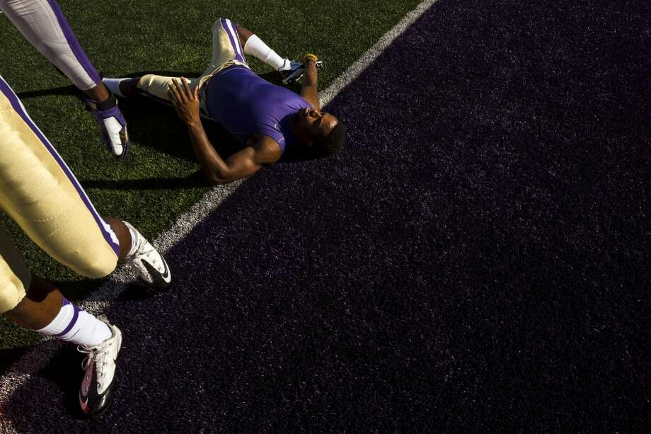 Husky football players stretch out and warm up before the opening season game against Boise State Saturday, August 31, 2013, in Seattle. (Jordan Stead, seattlepi.com) Photo: JORDAN STEAD, SEATTLEPI.COM