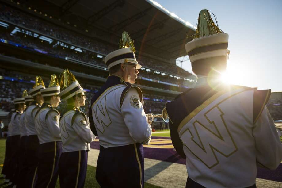 Members of the Husky Band await the start of the opening season game against Boise State Saturday, August 31, 2013, in Seattle. (Jordan Stead, seattlepi.com) Photo: JORDAN STEAD, SEATTLEPI.COM