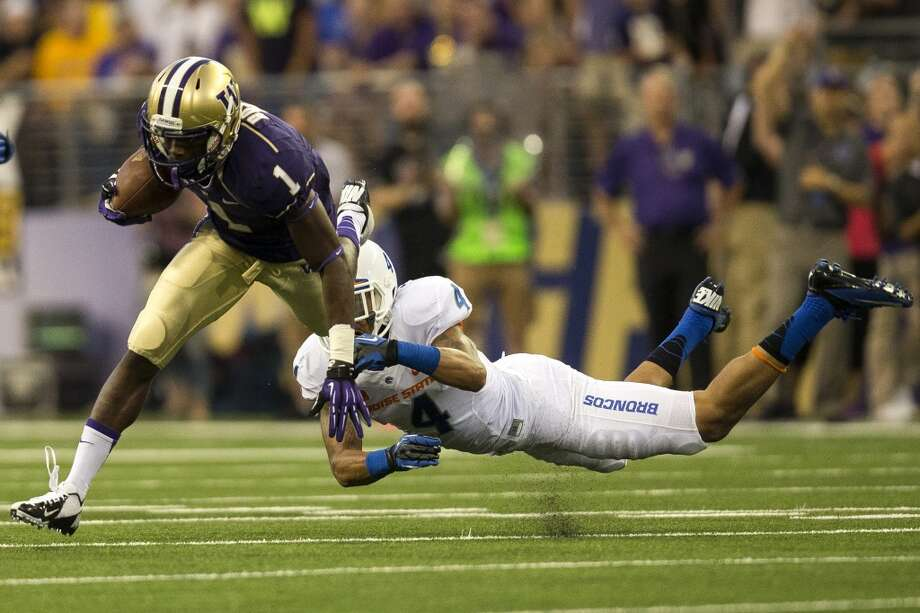 John Ross, left, evades a tackle by Darian Thompson, right, during the first half of the opening season game Saturday, August 31, 2013, at the University of Washington's newly-renovated Husky Stadium in Seattle. The Huskies led Boise State 10-3 at the half. (Jordan Stead, seattlepi.com) Photo: JORDAN STEAD, SEATTLEPI.COM