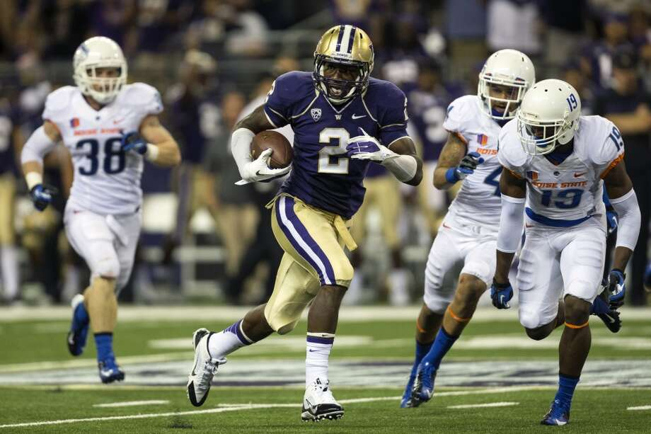 Kasen Williams, center, runs toward the end zone, dodging Boise State defense during the second half of the opening season game Saturday, August 31, 2013, at the University of Washington's newly-renovated Husky Stadium in Seattle. The Huskies beat Boise State 38-6. (Jordan Stead, seattlepi.com) Photo: JORDAN STEAD, SEATTLEPI.COM