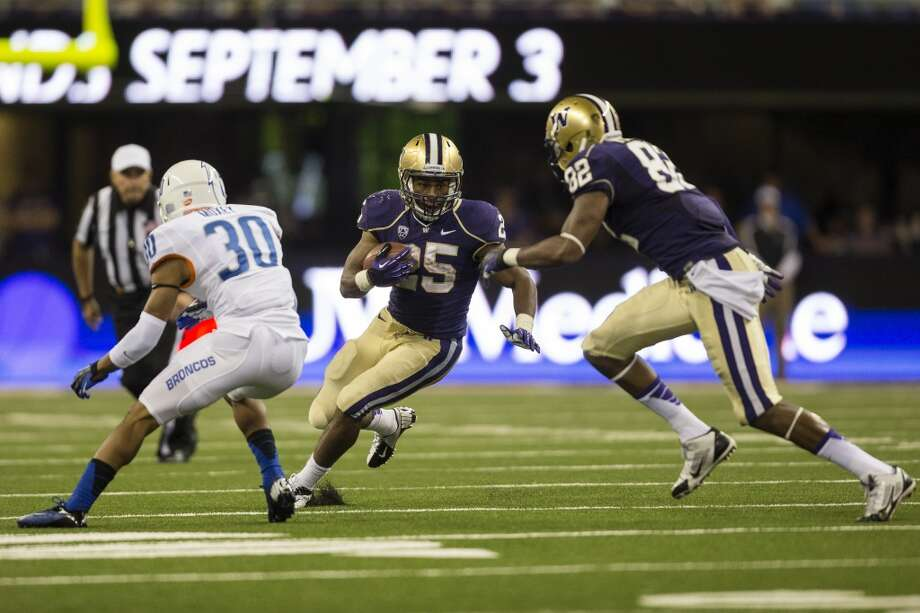 Bishop Sankey, center, runs it during the second half of the opening season game Saturday, August 31, 2013, at the University of Washington's newly-renovated Husky Stadium in Seattle. The Huskies beat Boise State 38-6. (Jordan Stead, seattlepi.com) Photo: JORDAN STEAD, SEATTLEPI.COM