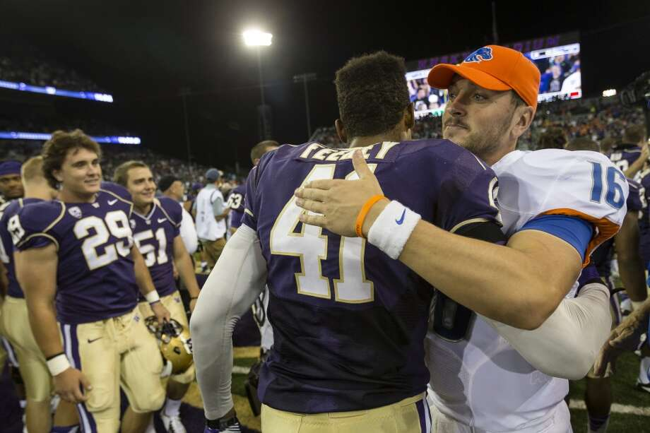 Boise State's Joe Southwick, right, embraces Travis Feeney, center, following the second half of the opening season game Saturday, August 31, 2013, at the University of Washington's newly-renovated Husky Stadium in Seattle. The Huskies beat Boise State 38-6. (Jordan Stead, seattlepi.com) Photo: JORDAN STEAD, SEATTLEPI.COM