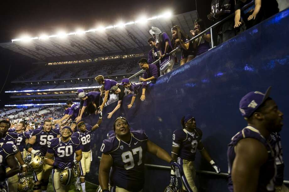Huskies walk off the field after beating Boise State at the opening season football game Saturday, August 31, 2013, at the University of Washington's newly-renovated Husky Stadium in Seattle. The Huskies beat Boise State 38-6. (Jordan Stead, seattlepi.com) Photo: JORDAN STEAD, SEATTLEPI.COM