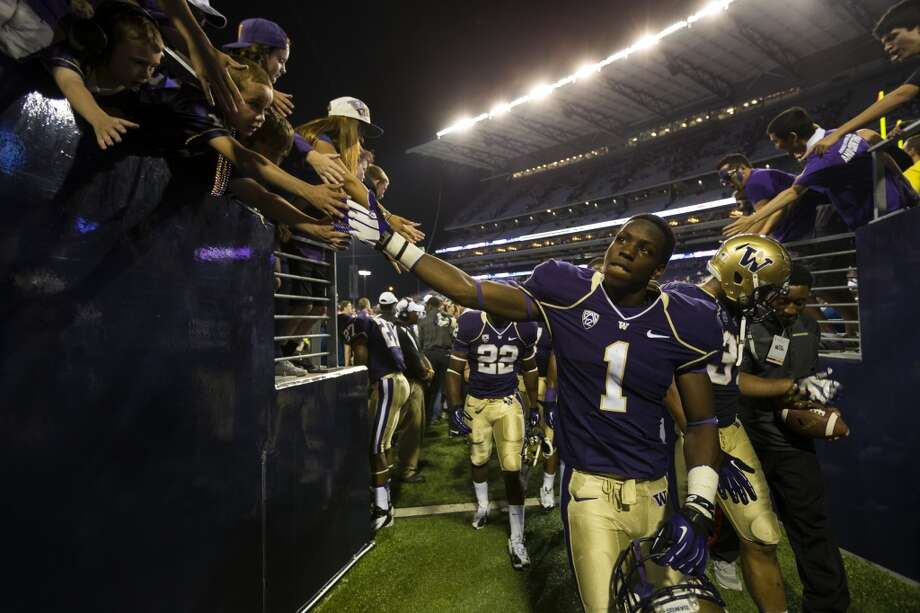 John Ross walks off the field after beating Boise State at the opening season football game Saturday, August 31, 2013, at the University of Washington's newly-renovated Husky Stadium in Seattle. The Huskies beat Boise State 38-6. (Jordan Stead, seattlepi.com) Photo: JORDAN STEAD, SEATTLEPI.COM